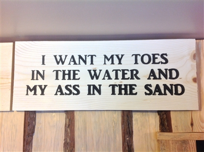 Carved sign: I Want My Toes in the Water & My Ass in the Sand