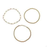Fine Pearls and Leather Jewelry by Designer Wendy Mignot Miami Arroz Gold and Pearl Stack Bracelets