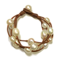 Fine Pearls and Leather Jewelry by Designer Wendy Mignot Music Four Strand Freshwater Bracelet White