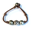 Fine Pearls and Leather Jewelry by Designer Wendy Mignot Om Woman Tahitian Bracelet