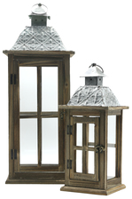 UTC31443 Wood Lantern with Metal Finial Top, Ring Handle, and, Cross and Glass Design Body Set of Two Natural Finish Brown