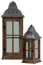 UTC31447 Wood Square Lantern with Pierced Metal Finial Top, Ring Handle, and, Window Pane and Glass Design Body Set of Two Natural Finish Brown