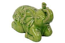 UTC50785 Ceramic Kneeling Trumpeting Elephant Figurine with Embossed Swirl Design Distressed Gloss Finish Yellow Green