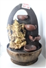 Gold Ganesh cascading fountain w/ black design arc and swirls in the background Model-3050