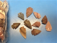 Mix agate arrowheads, natural stones of different variety of agate. Colorful display and variety
