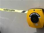 25m. Retractable Barrier Tape Yellow with text CAUTION