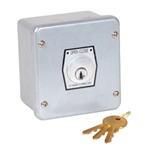 1KX Key Switch for Commercial Garage Door Applications with Open and Close Operations.