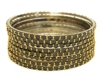 Black glass bangles from our Prism Collection.