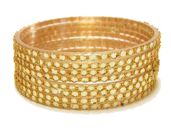 Gold glass bangles from our Prism Collection.