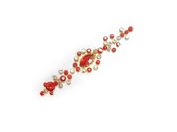 Extra large bindi made entirely of red and white crystals.