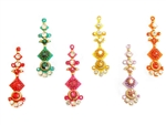 Large bindi in bold bright colors with matching crystals.