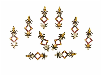 Unique bindi shape in black and red with gold silver and white crystals.