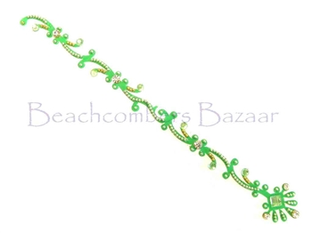 Parrot green with sparkling white crystals in a long tikka style bindi.