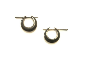 Small fat hoop earrings in black horn use a pin to pierce the ear.