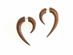 Wood earrings in elongated crescent tapers for men or women.
