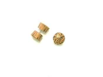Tan coconut wood with dark brown streaks creat little leapord print dots on thes fake plugs.