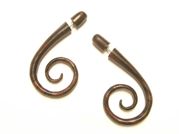 Two inch long fake gauges with a spiral at the bottom in wood.