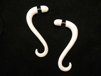 Two inch long fake gauges in a soft snake-like drop in bone.