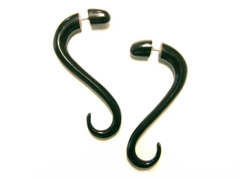 Two inch long fake gauges in a soft snake-like drop in black horn.