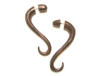 Two inch long fake gauges in a soft snake-like drop in wood.