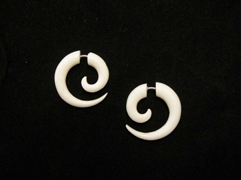 "Organic bone earrings carved into a spiral less than 1"" long."