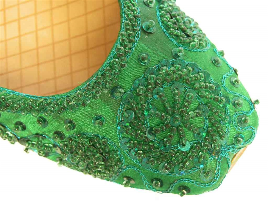 f75baed15e8 Khussa shoes in emerald green silk with matching beads and sequins.