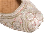 Warm white ivory silk with iridescent beads and sequins with gold threadwork.
