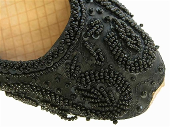 Rich black silk with matching beads and sequins cover these beautiful shoes.