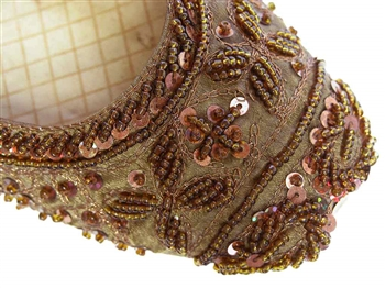 Brown silk covered with beads and sequins and matching threadwork in traditional Indian shoes.
