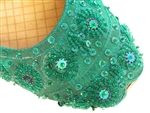 Indian shoes with teal green silk and matching beads and sequins.