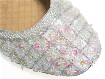 Silvery cool white silk with iridescent beads and sequins.<br>