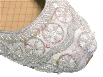 Wedding shoes in silvery white silk with iridescent beads and sequins.