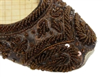 Dark brown silk covered with beads and sequins and matching threadwork in traditional Indian shoes.