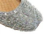Light ice blue silk Indian khussa shoes are covered with silver beads and sequins for women.