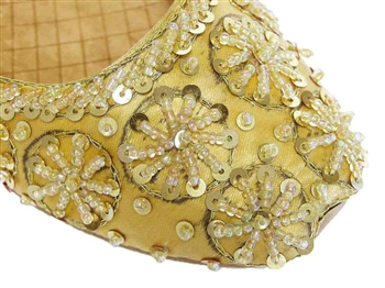 Gold silk with matching beads and sequins.