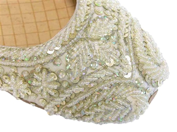 Light lemon cream silk with gold threadwork, iridescent beads, and gold sequins.