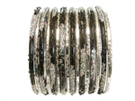 Metallic silver, and shiny black bangles with silver confetti glitter.