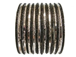 Solid black glitter bangles pair with metallic silver glass bangles.