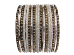 Sparkling silver metallic and glitter bangles accented with black bangles and gold glitter.