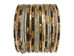 Variety of bangles with black, gray, and gold accents and glitter.