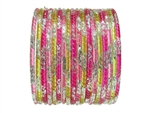 Pink, fuchsia, and yellow glass bangles with silver glitter accents.
