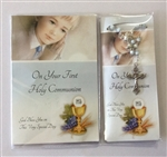 First holy communion booklet and rosary beads