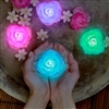 Floating LED Lights in rose shape make lovely centerpiece