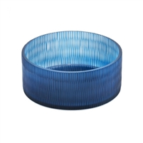 Sapphire blue glass bowl with facets showing light and dark blue ridges