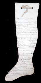 "A Letter to Santa Claus – written in rhyming verse and asking for more for the poor children. A pen and ink letter written on two 9 ½"" x 4 ½"" stock cut in the shape of a stocking. . .."