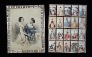 A Fine Box with Imagery of 2 Lovely Young Ladies in a Rose Garden on the Cover and 20 Trinket Boxes within- European Women c1840. One box with corner repair.  Light warping from storage in dry environment.
