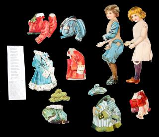 2 2-Sided Articulated Dollies Up to Date with 8 Front and Back Costumes. Misch & Co..London.[1910]