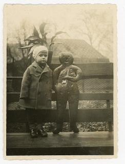 Snapshot - Young Child stands with Giant Gingerbread Man. .Essen Germany.1929