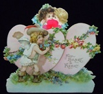 Winged Cowboy Cupid with Chains around Two Hearts with a Red Honeycomb - Brundage