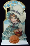 Honeycomb - Girl Wearing Bonnet has Basket of Valentine Hearts
